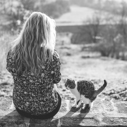 Blonde woman resting with her adorable cat