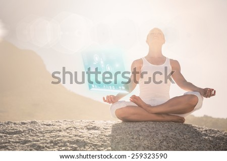 Blonde woman sitting in lotus pose on beach against fitness interface #259323590