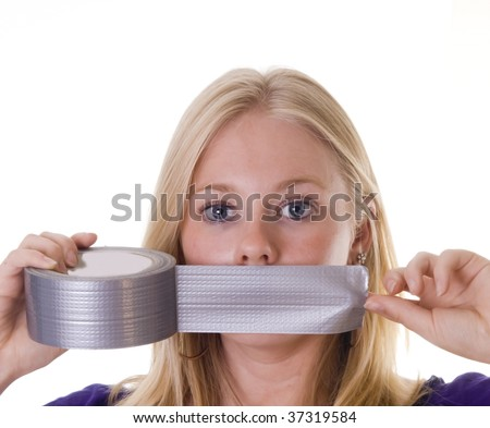 Blonde woman tapes her mouth with duct tape