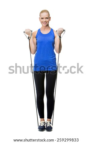 blonde woman wearing fitness clothing exercising with rubber band