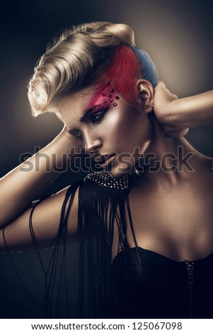 blonde woman with colourful make-up