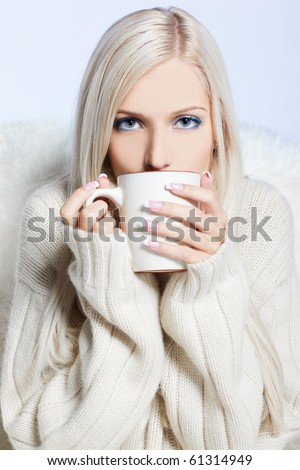blonde woman with cup of hot coffee or tea