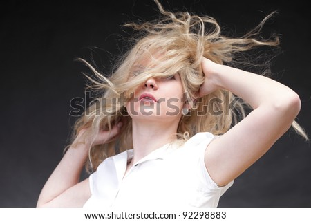 Blonde woman with her hair blowing in the wind