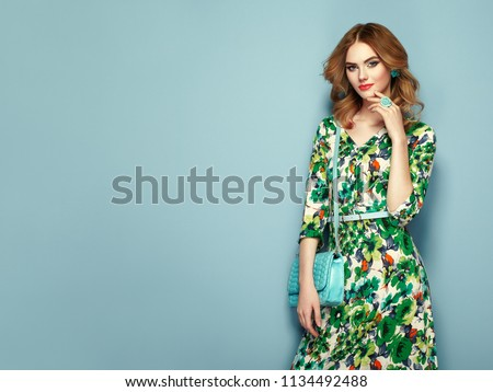 086f804d186 Blonde young woman in floral spring summer dress. Girl posing on a pink  background.