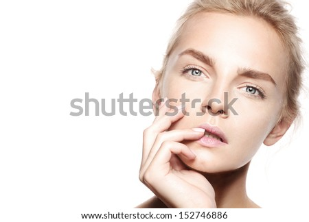 Blonde young woman with natural make-up and nude manicure fashion, perfect light skin