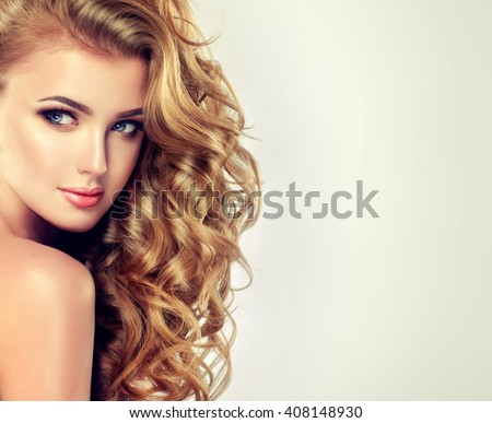 Shutterstock Blondel girl with long wavy hair .  Beautiful  model with curly hairstyle