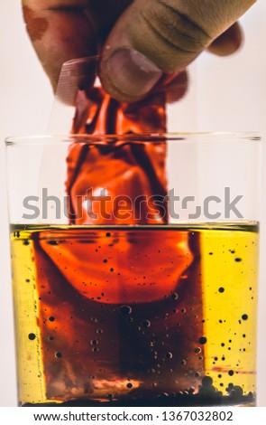 blood bag in yellow liquid #1367032802