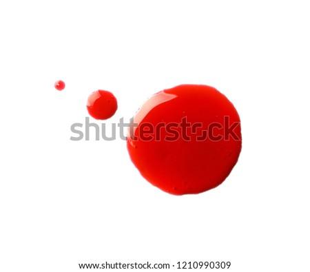Blood blots on white background #1210990309