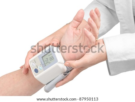 Blood pressure measurement with a digital monitor.