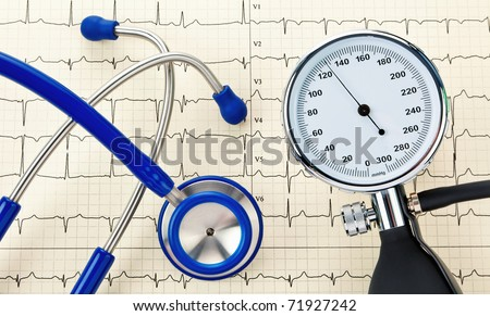 Blood pressure monitor, stethoscope and ECG curve. Correct blood pressure measurement.