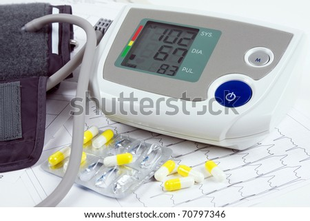 blood pressure monitor, tablets and ECG