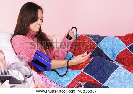 blood pressure of girl sitting at bed
