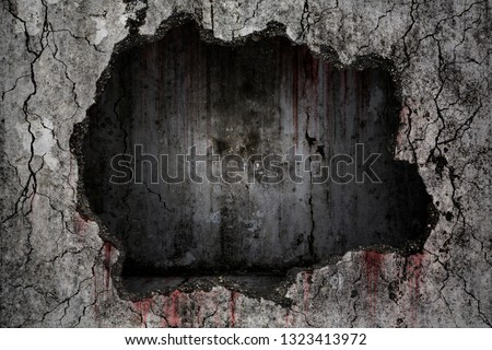Photo of  Bloody background scary on damaged grungy crack and broken concrete wall with empty dark room inside on the wall, concept of horror