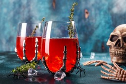 Bloody Halloween party cocktail garnished with thyme, Cranberry punch
