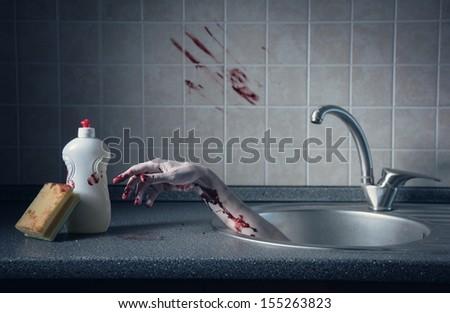 Bloody hand in kitchen sink, Halloween concept or crime scene