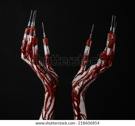 Bloody hand with syringe on the fingers, toes syringes, hand syringes, horrible bloody hand, halloween theme, zombie doctor, black background, isolated