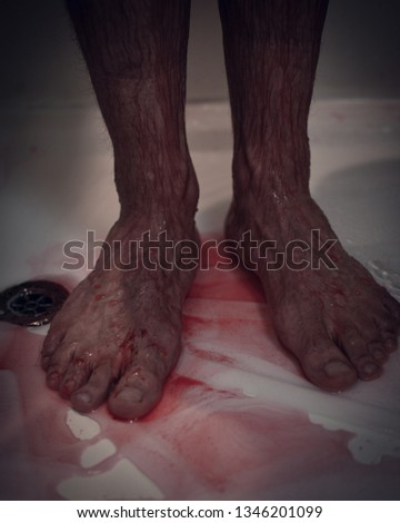 bloody legs of a killer in the shower