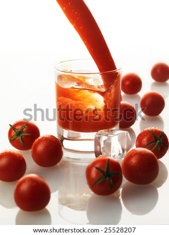 stock photo : bloody mary cocktail with splash of juice and tomatoes...