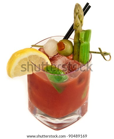 Bloody mary, traditional cocktail isolated on a white background loaded with garnishes