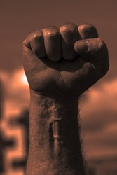 Bloody sunset red clenched fist of adult male. Power to the people, socialism, communism, revolution, workman concept