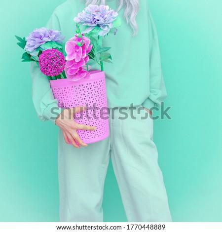 Blooming Summer look. Vanilla flowers casual Girl. Aqua menthe design trends Stock photo ©