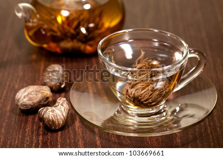 Blooming tea in a glass cup with 3 variety of hand made teas