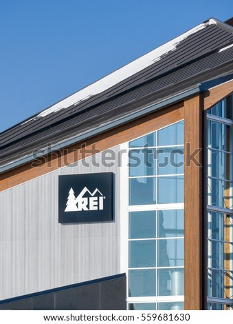 BLOOMINGTON, MN/USA - JANUARY 14, 2017: REI store exterior and logo. Recreational Equipment Inc. is a retail cooperative, selling outdoor recreation gear, sporting goods, and clothing.