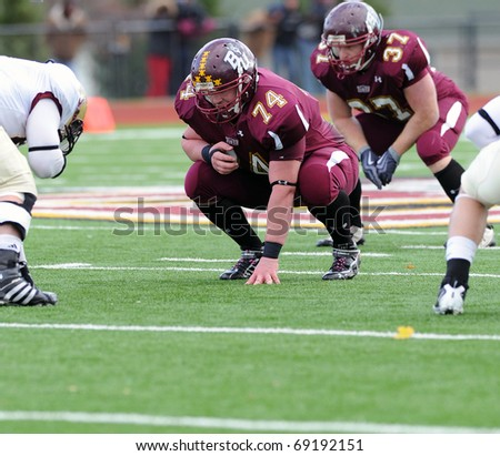 BLOOMSBURG, PA - NOVEMBER 6: Bloomsburg University offensive lineman Pat Casey (#74) shown in a three point stance waiting for a snap in a football game November 6, 2010 in Bloomsburg, PA