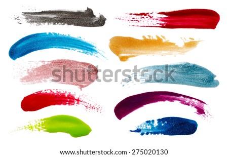 Blots of nail polish isolated on white background