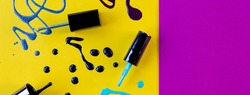 Blots of purple, blue nail polish isolated on bright background.Nail Polish Splashes. art set. Blots of mixed multicolor samples.paint splash isolated on yellow. Web banner.copy space