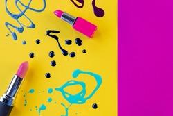Blots of purple, blue nail polish isolated on bright background.Nail Polish Splashes. art set. Blots of mixed multicolor samples.paint splash isolated on yellow