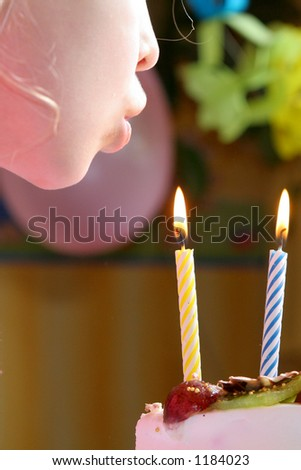 Blowing birthday candles
