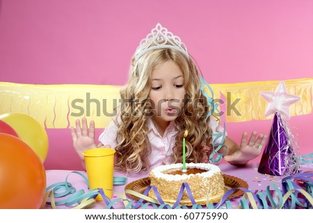 blowing candles birthday party little blond happy girl