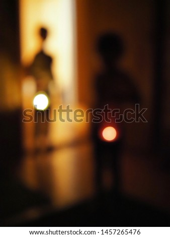 Blue abstract background blur kids with flashlights in dark room. the concept of children's fears and fear of the dark #1457265476