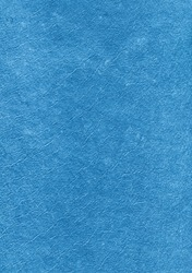 Blue abstract background. Felt material texture. Warm fleecy crushed wool fiber structure.