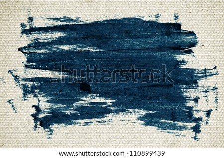 Blue abstract hand-painted brush stroke daub over vintage old paper