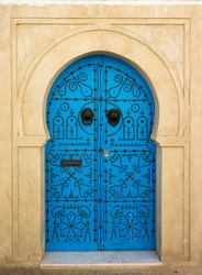 Blue aged door with ornament from Sidi Bou Said in Tunisia