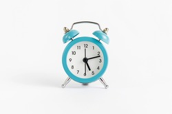 Blue alarm clock on white background. Time and deadline concept