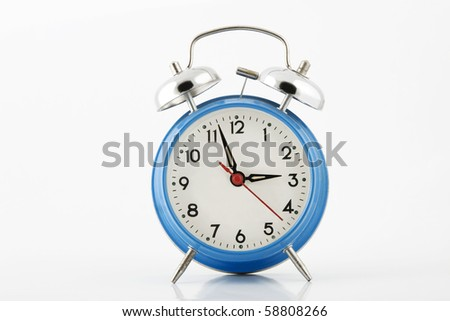 blue alarm-clock with silver bell on white background