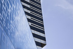 Blue and blackline modern building with Sky.Concepts of financial
