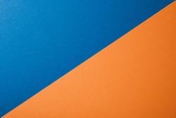 Blue and orange color paper background, texture, copy space, diagonal.