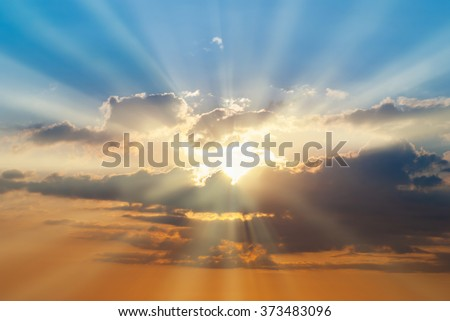 Blue and orange sunset sky with rays of sun. Natural landscape for background #373483096