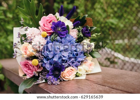 Blue and pink bouquet of flowers wrapped in paper bunch of fresh blue and pink bouquet of flowers wrapped in paper bunch of fresh blue hydrangea mightylinksfo