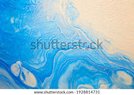 Blue and pink colors abstract hand painted fluid art texture. Close-up creative background for your design
