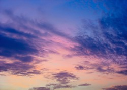 Blue and pink evening sky. Clouds at sunset