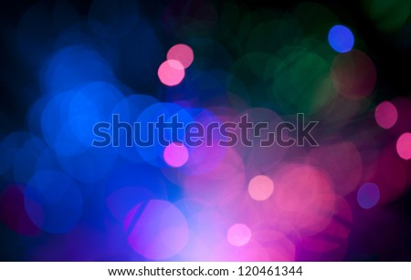Blue and pink festive lights and circles background. Blurred christmas lights