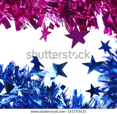 Blue and purple christmas tinsel. Isolated on a white background.