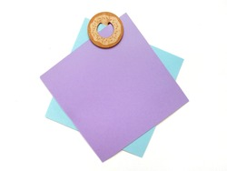 Blue and purple paper colors was clipped with wooden clip in doughnut shape isolated on white background with note space. It can write text on paper note or on white space.