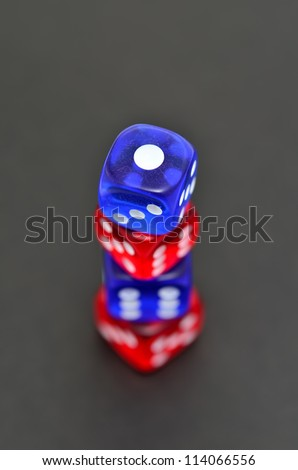 Blue and red dice on the black background.