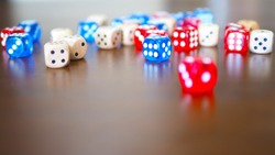 blue and red dices game on wooden table top selected focus